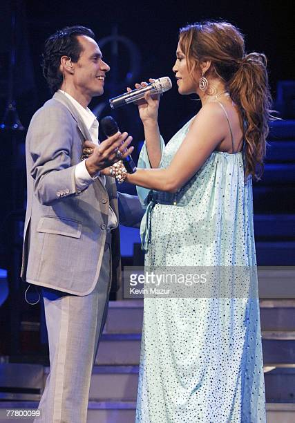 MIAMI FL NOVEMBER 07 Marc Anthony and Jennifer Lopez announce Lopez's pregnancy on stage during their 'En Concierto' tour November 7 2007 in Miami...