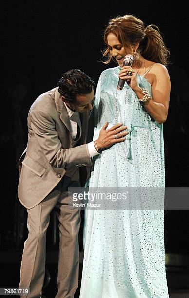 """Marc Anthony and Jennifer Lopez announce Lopez's pregnancy on stage during their """"En Concierto"""" tour November 7, 2007 in Miami, Florida."""