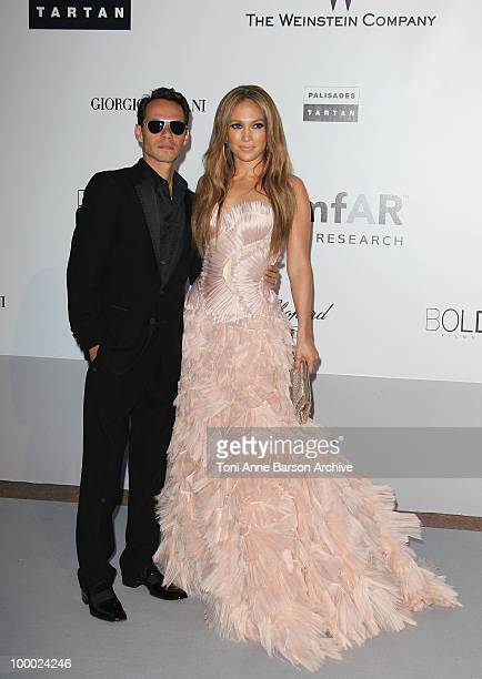 Marc Anthony and Jennifer Lopez attend the amfAR Cinema Against AIDS 2010 at the Hotel du Cap during the 63rd Annual Cannes Film Festival on May 20...