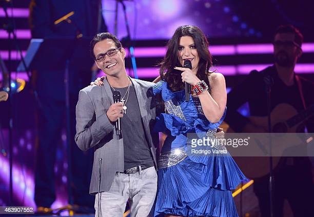 Marc Anthony and Laura Pausini perform onstage at the 2015 Premios Lo Nuestros Awards at American Airlines Arena on February 19 2015 in Miami Florida