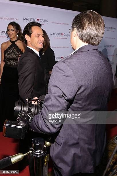 Marc Anthony greets Kevin Mazur at the 2015 Maestro Cares Gala at Cipriani Wall Street on February 17 2015 in New York City