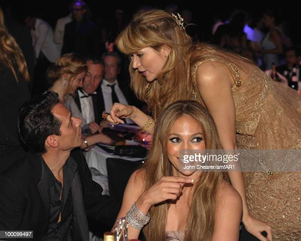 Marc Anthony Jennifer Lopez and Gulnara Karimova attend amfAR's Cinema Against AIDS 2010 benefit gala dinner at the Hotel du Cap on May 20 2010 in...
