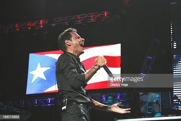 Marc Anthony performs with Pitbull on 'Vivir Mi Vida' World Tour at Coliseo Jose M Agrelot on October 5 2013 in San Juan Puerto Rico