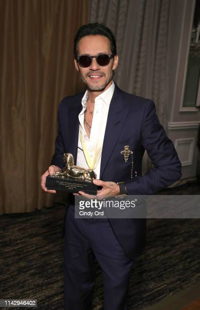 Marc Anthony poses with his Sphinx award as the Hasty Pudding Institute Of 1770 honors him at the 7th Annual Order Of The Golden Sphinx Gala at The...