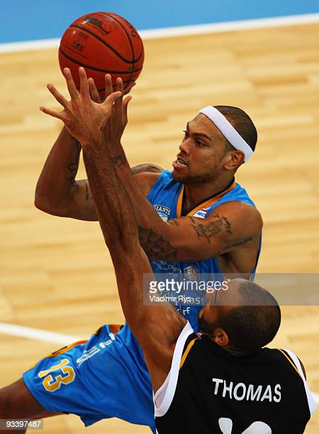 Marc Antonio Carter of Giants is defended by Jay Thomas of Tigers during the Beko Basketball Bundesliga game between Giants Duesseldorf and Walter...