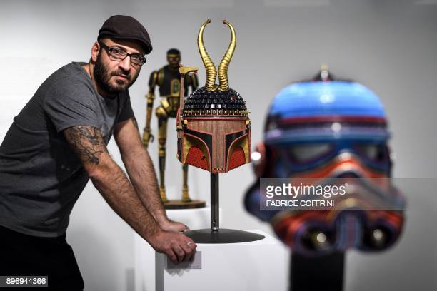 Marc Atallah Swiss director and curator of science fiction museum The Maison d'Ailleurs poses near works by US artist Gabriel Dishaw during the...