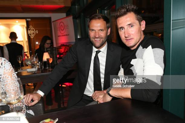 Marc Autmaring director Wempe Weinstrasse Munich and soccer player Miroslav Klose during the piano night hosted by Wempe and Glashuette Original at...