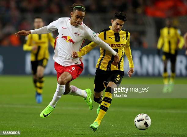 Marc Barta Aregall of Dortmund and Yussuf Poulsen of Leipzig battle for the ball during the Bundesliga match between Borussia Dortmund and RB Leipzig...