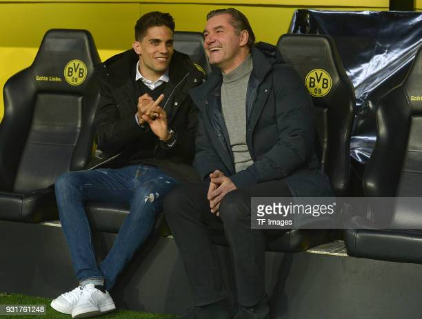 Marc Bartra and Sporting director Michael Zorc of Dortmund laugh prior to UEFA Europa League Round of 16 match between Borussia Dortmund and FC Red...