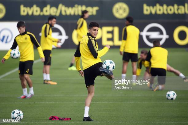 Marc Bartra controls the ball during a Borussia Dortmund training session ahead of their UEFA Champions League Group H match against Real Madrid at...