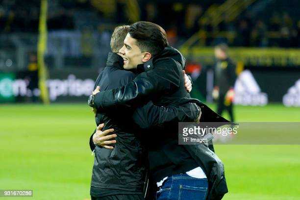 Marc Bartra ex player of Borussia Dortmund says farewell with player Marcel Schmelzer of Dortmund during the UEFA Europa League Round of 16 match...