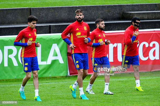 Marc Bartra Gerard Pique Jordi Alba and Pedro Rodriguez of Spain warm up during a training session on May 30 2016 in Schruns Austria