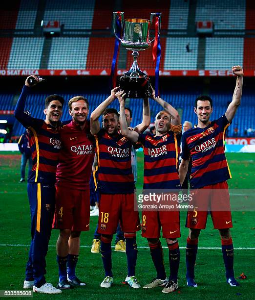 Marc Bartra Ivan Rakitic Jordi Alba Andres Iniesta and Sergio Busquets Burgos of FC Barcelona hold the trophy in celebration after winning the Copa...