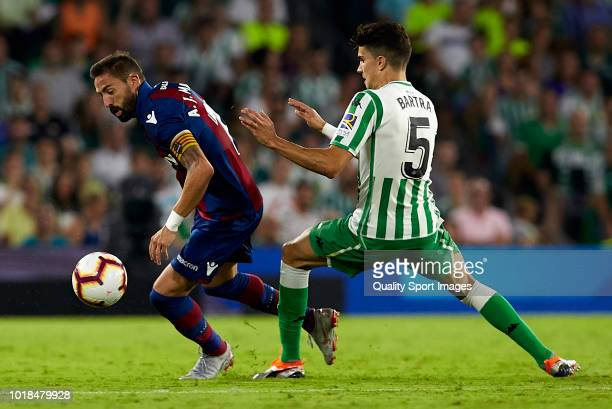 Marc Bartra of Betis competes for the ball with Jose luis Morales of Levante during the La Liga match between Real Betis Balompie and Levante UD at...