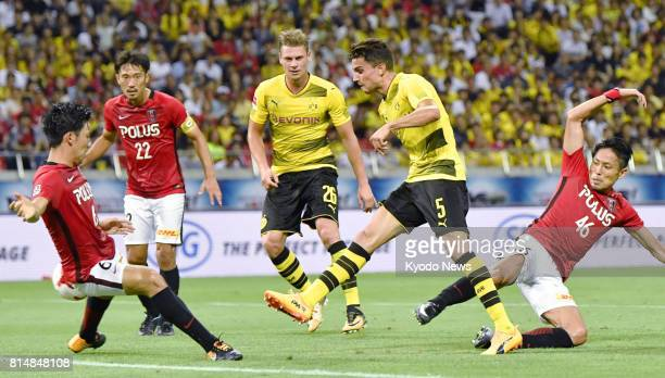 Marc Bartra of Borussia Dortmund aims to make a shot on goal during the first half of an international friendly against Urawa Reds at Saitama Stadium...