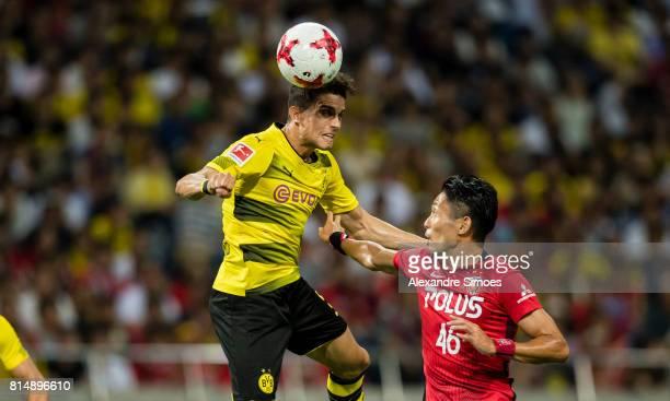 Marc Bartra of Borussia Dortmund and Ryota Moriwaki during the preseason friendly match between Urawa Red Diamonds and Borussia Dortmund at Saitama...