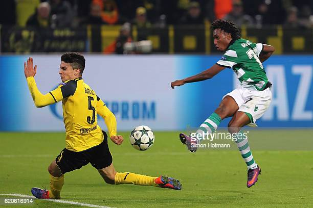 Marc Bartra of Borussia Dortmund attempts to block as Gelson Martins of Sporting CP shoots on goal during the UEFA Champions League Group F match...
