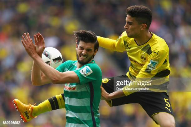 Marc Bartra of Borussia Dortmund battles for the ball with Florian Grillitsch of Werder Bremen during the Bundesliga match between Borussia Dortmund...