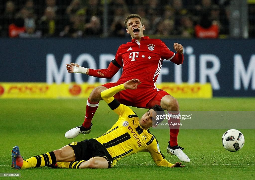 Marc Bartra (L) of Borussia Dortmund in action against Thomas Mueller(R) of Bayern Munich during the Bundesliga football match between Borussia Dortmund and FC Bayern Munich at the Signal Iduna Park in Dortmund, Germany on November 19, 2016.