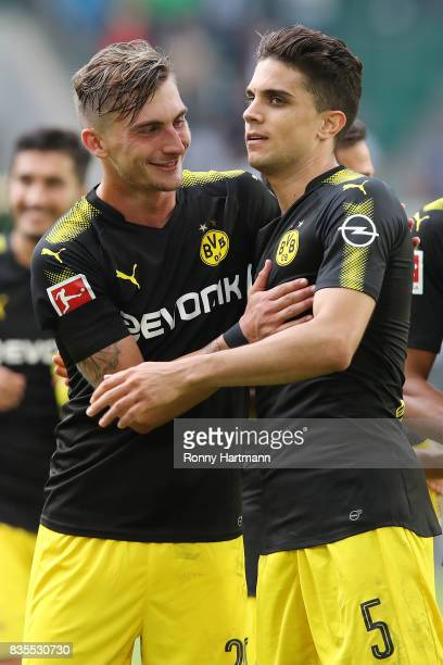 Marc Bartra of Borussia Dortmund is congratulated by Maximilian Philipp of Borussia Dortmund after the Bundesliga match between VfL Wolfsburg and...