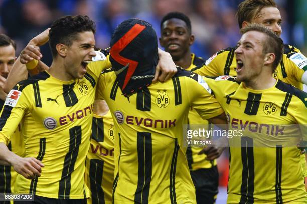 Marc Bartra of Borussia Dortmund Pierre Emerick Aubameyang of Borussia Dortmund and wears a mask Felix Passlack of Borussia Dortmundduring the...
