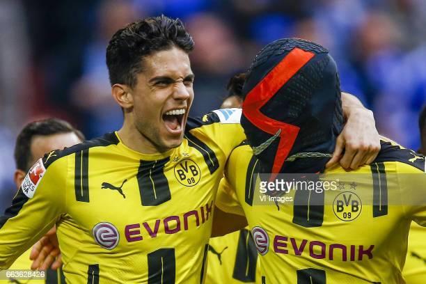 Marc Bartra of Borussia Dortmund Pierre Emerick Aubameyang of Borussia Dortmund with mask after he scoredduring the Bundesliga match between Schalke...
