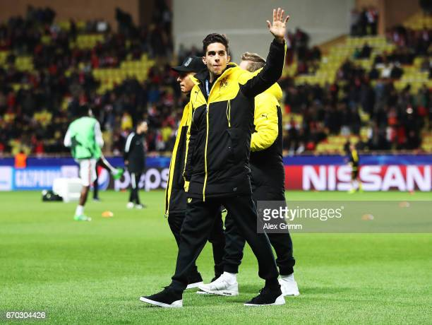 Marc Bartra of Borussia Dortmund who was injured in last weeks bus bombing waves to fans before the UEFA Champions League Quarter Final second leg...
