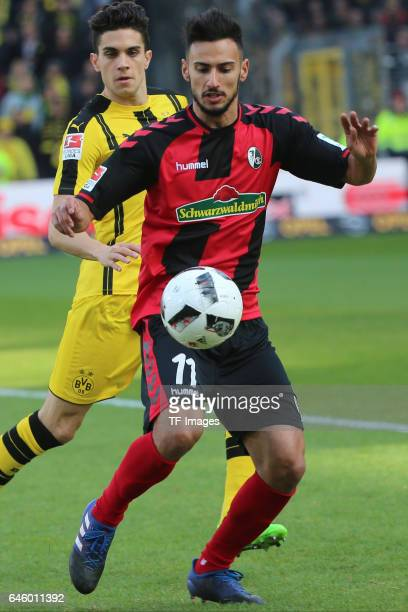 Marc Bartra of Dortmund and Onur Bulut of Freiburg battle for the ball during the Bundesliga match between Sport Club Freiburg and Borussia Dortmund...