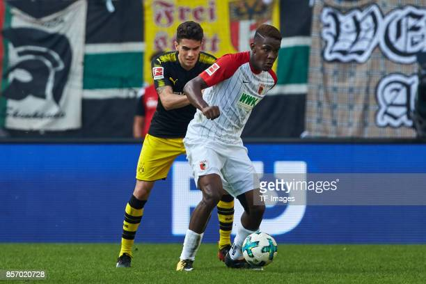Marc Bartra of Dortmund and Sergio Cordova of Augsburg battle for the ball during the Bundesliga match between FC Augsburg and Borussia Dortmund at...