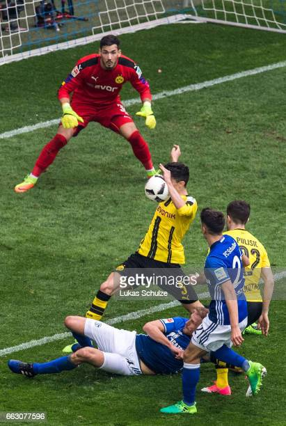 Marc Bartra of Dortmund gets the ball on his hand during the Bundesliga match between FC Schalke 04 and Borussia Dortmund at VeltinsArena on April 1...