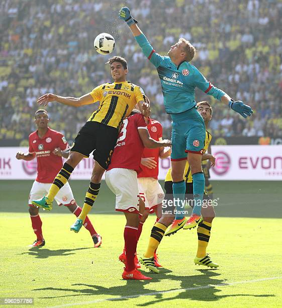 Marc Bartra of Dortmund goes up for a header with Jonas Loessl of Mainz during the Bundesliga match between Borussia Dortmund and 1 FSV Mainz 05 at...