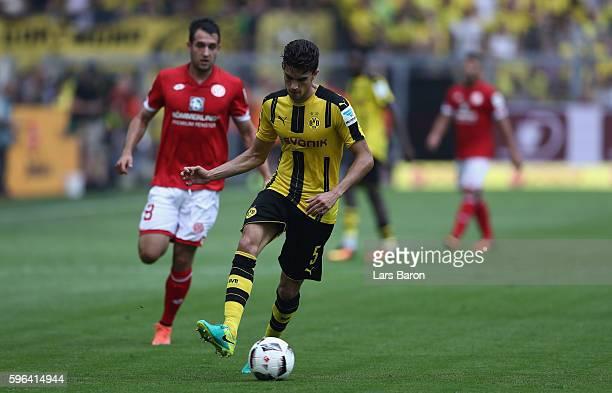 Marc Bartra of Dortmund runs with the ball during the Bundesliga match between Borussia Dortmund and 1 FSV Mainz 05 at Signal Iduna Park on August 27...