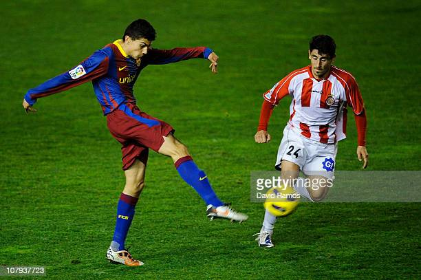 Marc Bartra of FC Barcelona B shoots towards goal under the challange of Peragon during the La Liga Adelante match between FC Barcelona B and Girona...