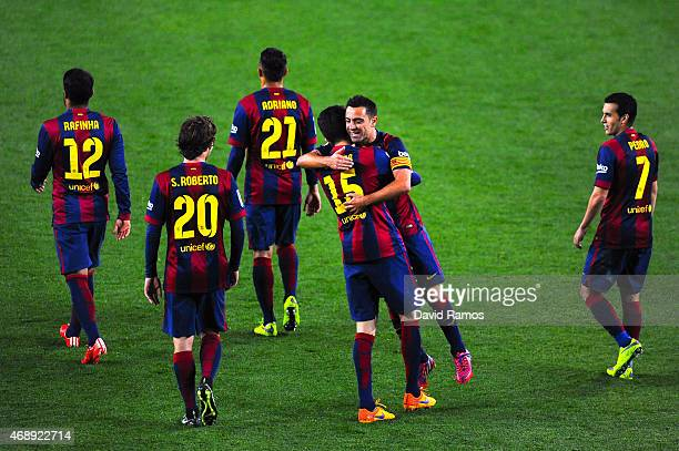 Marc Bartra of FC Barcelona celebrates with his teammate Xavi Hernandez of FC Barcelona after scoring his team's third goal during the La Liga match...