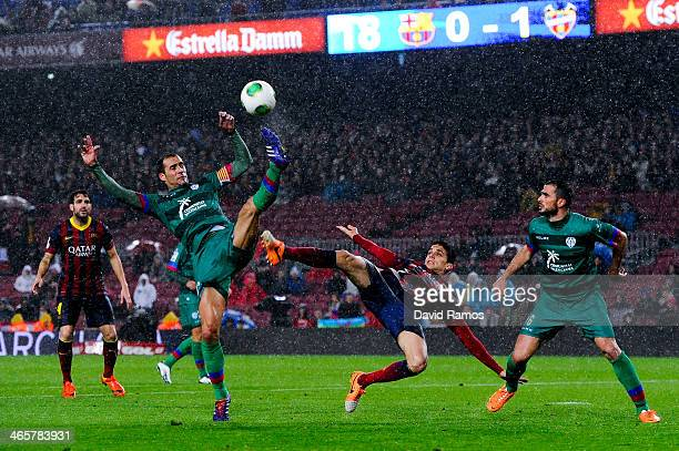 Marc Bartra of FC Barcelona duels for the ball with Juanfran and Vyntra of Levante UD during the Copa del Rey Quarter Final 2nd leg match between FC...