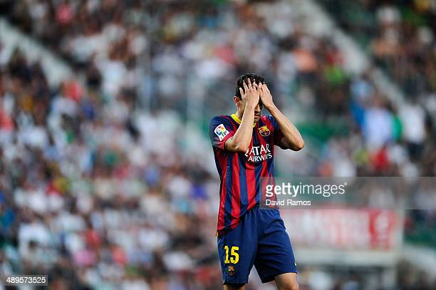 Marc Bartra of FC Barcelona reacts during the La Liga match between Elche FC and FC Barcelona at Estadio Manuel Martinez Valero on May 11 2014 in...