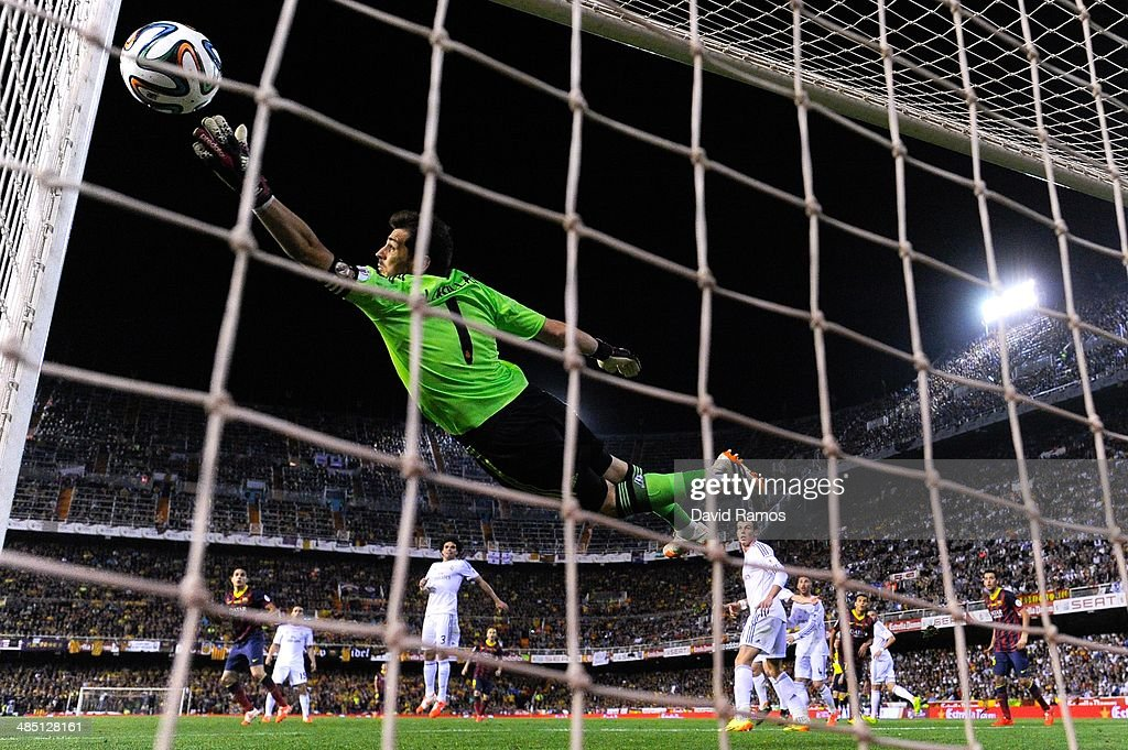 Marc Bartra (L) of FC Barcelona scores his team's first goal during the Copa del Rey Final between Real Madrid and FC Barcelona at Estadio Mestalla on April 16, 2014 in Valencia, Spain.