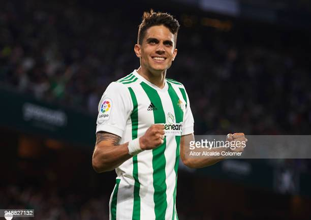 Marc Bartra of Real Betis Balompie celebrates after scoring his team mate Junior Firpo of Real Betis Balompie during the La Liga match between Real...