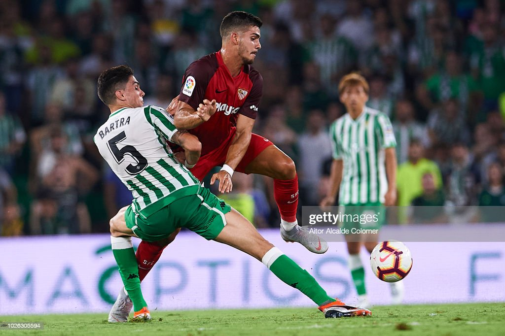 Marc Bartra of Real Betis Balompiof Real Betis Balompie (L) competes for the ball with Andre Silva of Sevilla FC (R) during the La Liga match between Real Betis Balompie and Sevilla FC at Estadio Benito Villamarin on September 2, 2018 in Seville, Spain.