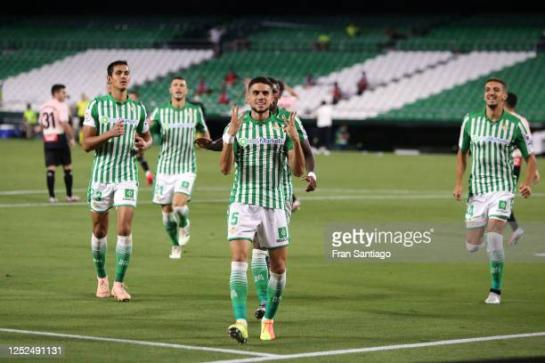 Marc Bartra of Real Betis celebrates scoring his teams first goal of the game with team mates during the Liga match between Real Betis Balompie and...