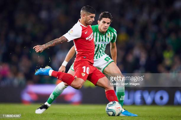 Marc Bartra of Real Betis competes for the ball with Ever Maximiliano Banega of Sevilla FC during the Liga match between Real Betis Balompie and...