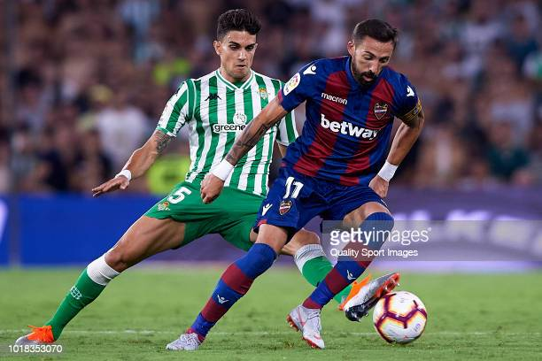 Marc Bartra of Real Betis competes for the ball with Jose Luis Morales of Levante UD during the La Liga match between Real Betis Balompie and Levante...