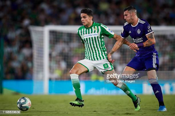 Marc Bartra of Real Betis competes for the ball with Sergi Guardiola of Real Valladolid during the Liga match between Real Betis Balompie and Real...