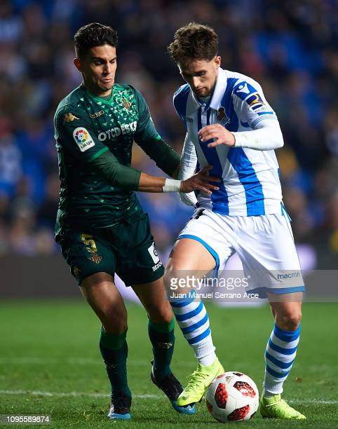 Marc Bartra of Real Betis duels for the ball with Adnan Januzaj of Real Sociedad during the Copa del Rey Round of 16 second leg match between Real...