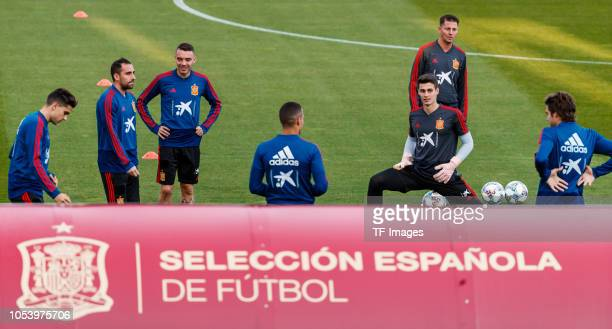 Marc Bartra of Spain Paco Alcacer of Spain Iago Aspas of Spain smile and Kepa Arrizabalaga of Spain looks on during a training session on October 8...