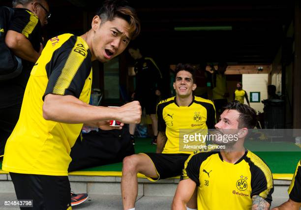 Marc Bartra Shinji Kagawa and goal keeper Roman Buerki of Borussia Dortmund after a training session as part of the training camp on July 31 2017 in...