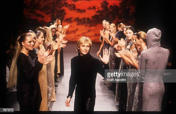 Marc Bauwer waves February 17, 1999 during the Marc Bouwer 1999 Fall Fashion Show in New York City. Fashion designer Marc Bauwer has chosen an outer...