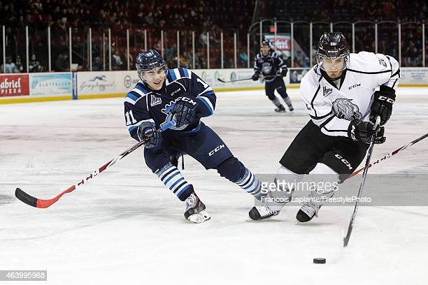 Marc Beckstead of the Gatineau Olympiques controls the puck against Timothe Simard of the Chicoutimi Sagueneens on February 20, 2015 at Robert...