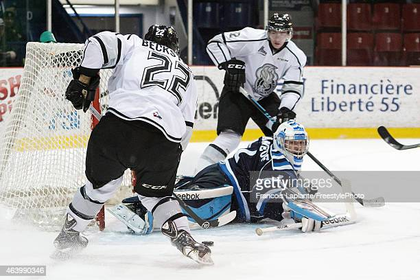Marc Beckstead of the Gatineau Olympiques shoots the puck as he scores his second period goal against Storm Phaneuf of the Chicoutimi Sagueneens on...