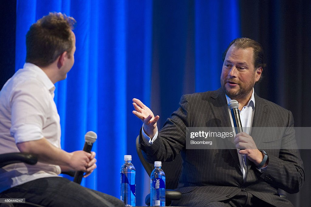 Marc Benioff, chairman and chief executive officer of Salesforce.com Inc., right, speaks as Drew Houston, chief executive officer and co-founder of Dropbox Inc., listens during the DreamForce Conference in San Francisco, California, U.S., on Monday, Nov. 18, 2013. Salesforce.com Inc. introduced an overhauled version of its mobile software, seeking to ensure clients and partners will be able to use more features of the company's sales, marketing and customer service software. Photographer: David Paul Morris/Bloomberg via Getty Images